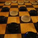 440px-Checkers_partsnpieces